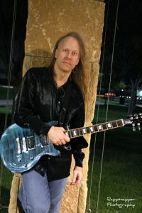 Michael Harris with his guitar